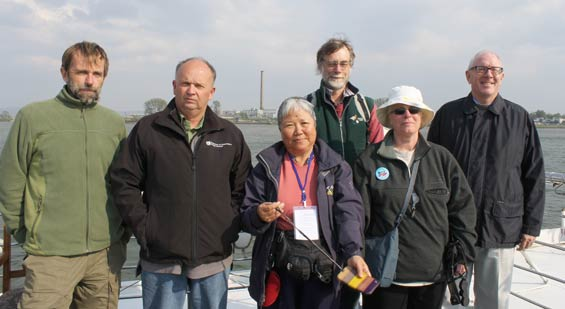 Pukorokoro Miranda Naturalists Trust and DOC with NZ Ambassador on the Yalu River, North China.  L to R: Adrian Riegen - Vice Chair MN,  Bruce McKinlay - DOC Techincal Advisor, Estella Lee - Councillor MNT, Keith Woodley - Manager of Miranda Shorebird Centre, Carol West - Director Terrestrial Ecosystems at DOC, HE Carl Worker - NZ Ambassador to China. © Bruce McKinlay Department of Conservation – New Zealand