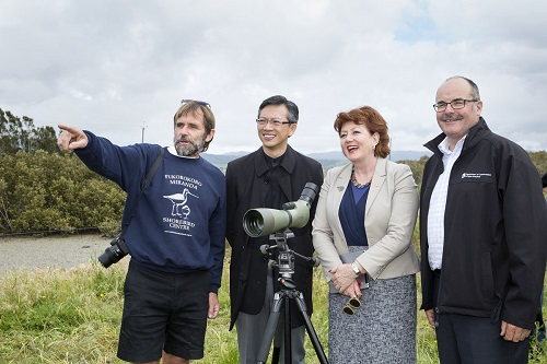 Viewing godwits and red knots at Pukorokoro-Miranda from left Adrian Riegen (Deputy Chair and Convenor of the NZ Wader Studies Group), Chinese Ambassador Wang,  Maggie Barry (Conservation Minister) and Lou Sanson (DOC Director-General)