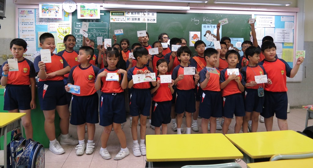 Hong Kong kids with SBS postcards they drew